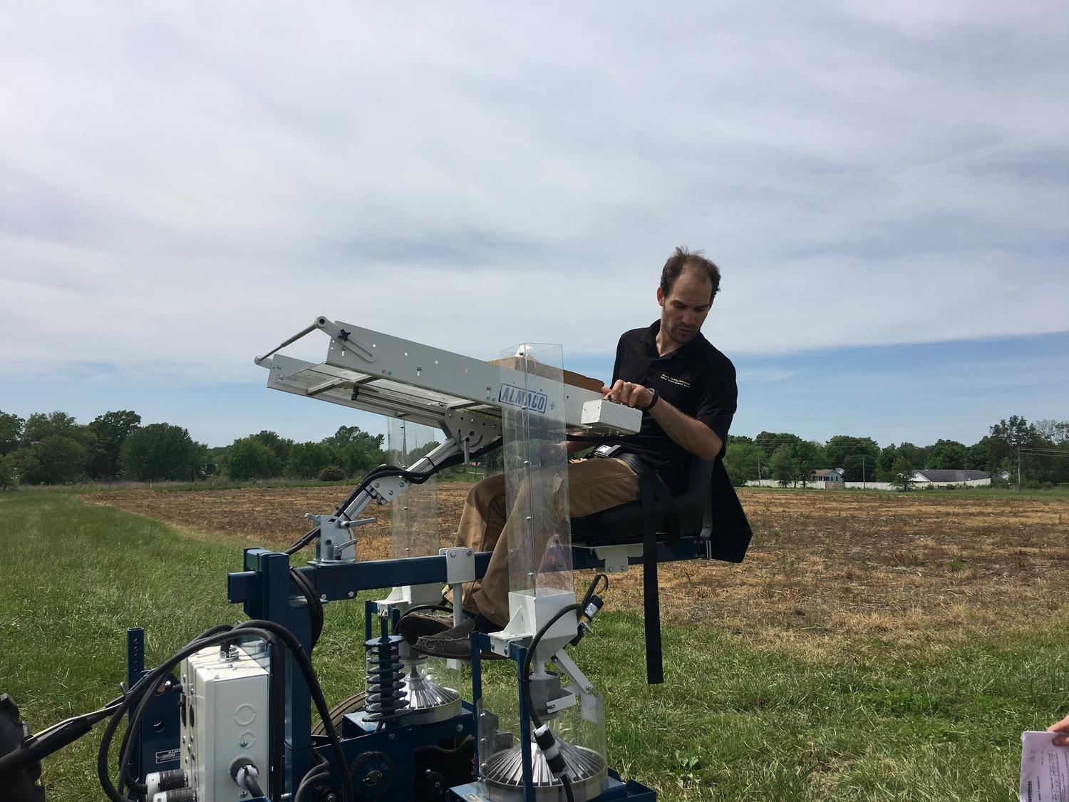 Professor Tim Beissinger on a tractor during the planting phase of the experiment