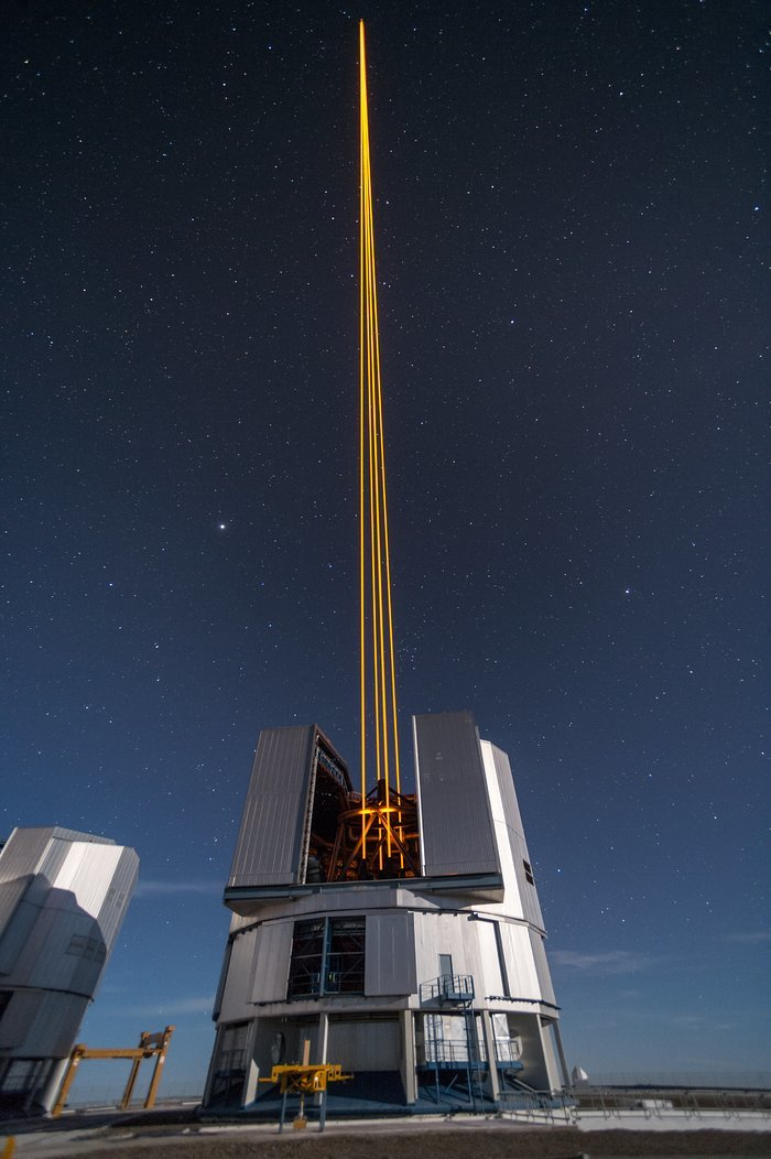 The telescope used to view the 2,000-year-old remnant of the nova: the most powerful laser guide star system in the world showing its four laser beams coming from the system at the main telescope 4 at the VLT (Very Large Telescope).