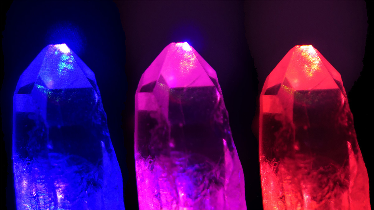 Image of quartz crystals under illumination with strong laser fields of different coloured light (red and blue), and both colours added together (middle).