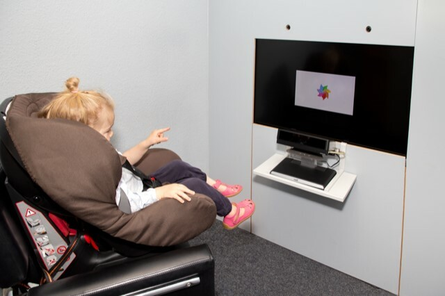 """A child listening to a recording as part of the ManyBabies project. The """"listening time"""" is calculated by measuring how long the child stares at a neutral stimulus."""