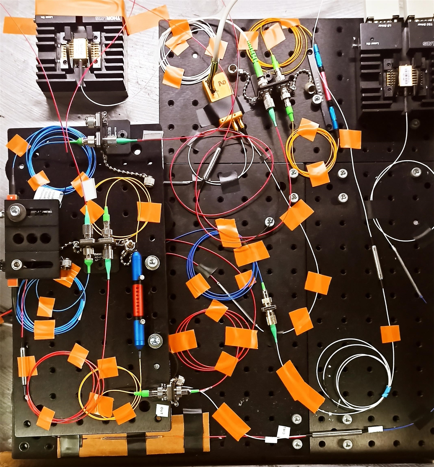 Experimental setup of the dendritic components of ADOPD consist of light conductors (rolled up), connectors (silver) and optical computing components (colored or black)