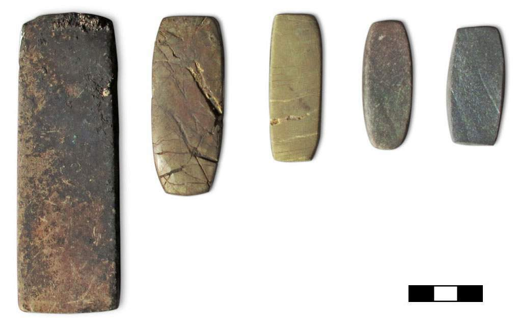 Mathematical analysis of balance weights (like the Bronze Age balance weights from southern Italy shown here) and metal scraps in Italy and Central Europe show that the weight unit (shekel) matches the weight of the metal scraps. This suggests that they were used as a common currency across Europe. (scale bar = 3cm)